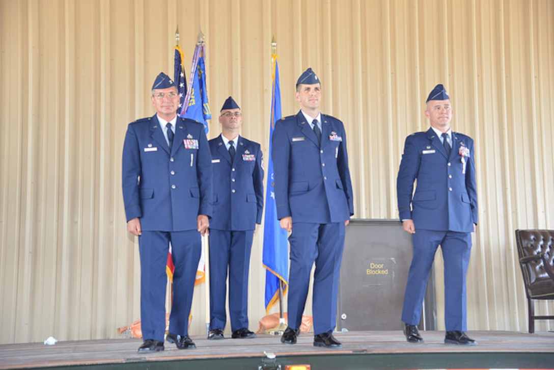 Maj. James Gutierrez (center) takes command of the 898th Munitions Support Squadron June 28 in  ceremony here. (Air Force photo by Jessie Perkins)
