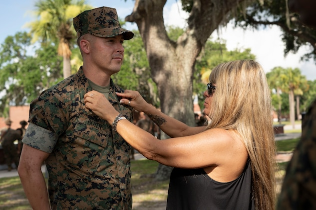 Tammie Ashely pins Gunnery Sgt. Justin Boyer during his promotion ceremony aboard Marine Corps Recruit Depot Parris Island July 2.