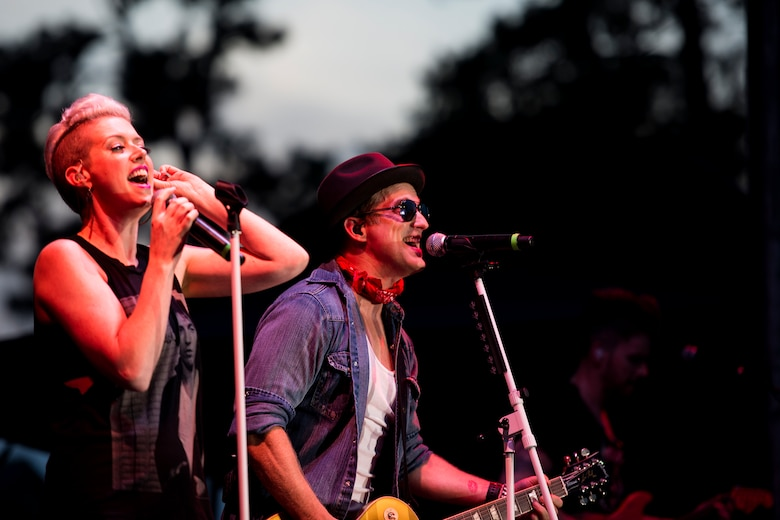 Keifer, right, and Shawna Thompson, lead singers of country band Thompson Square, perform a concert during the Patriot Festival, July 3, 2018, at Moody Air Force Base, Ga. Team Moody hosted the free event to allow Airmen and their families an opportunity to take some time away from the mission and enjoy a Fourth of July experience. The event consisted of live music, food trucks, family fun and a firework show. (U.S. Air Force photo by Airman 1st Class Erick Requadt)