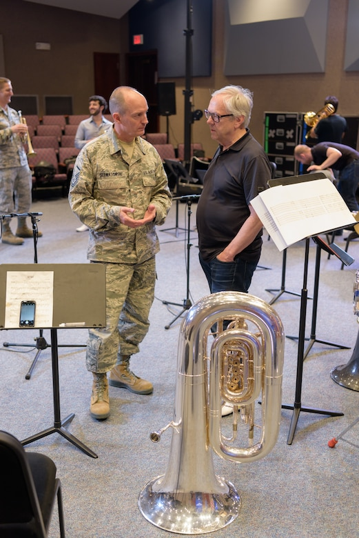 U.S. Air Force Master Sgt. Alex Serwatowski, Heartland of America Band section chief of publicity and tuba player, and Chuck Daellenbach, Canadian Brass tuba player, speak before their collaborative rehearsal June 8, 2018, at Offutt Air Force Base, Nebraska. Canadian Brass, formed in 1970, has won Juno, Grammy and Echo awards and is considered to be one of the most successful brass ensembles in the world. (U.S. Air Force photo by Senior Airman Jacob Skovo)