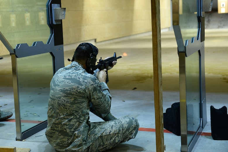 Staff Sgt. Tyler Senecal, 55th Security Forces Squadron training instructor, fires a M-16 rifle at a paper target during an excellence in competition and shooting event May 14, 2018, at Offutt Air Force Base, Nebraska. Offutt's defenders participated in local events as well as coordinating base events to recognize the contributions of police across the nation. (U.S. Air Force photo by Charles J. Haymond)