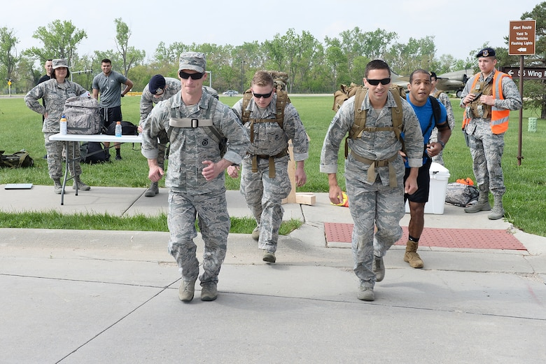 55th Security Forces Squadron Airmen begin to run during a ruck march challenge May 14, 2018, at Offutt Air Force Base, Nebraska. Team two ran and walked 2 miles from the Patriot Club parking lot to Peacekeeper Drive in 38 minutes and 25 seconds to earn first place in this challenge.  (U.S. Air Force photo by Charles J. Haymond)