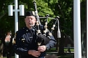 """Sgt. Jeremy Christensen, Omaha Police Department, plays """"Amazing Grace"""" on his bag pipes during a retreat ceremony honoring Police Week May 17, 2018, at Offutt Air Force Base, Nebraska. Offutt's Police Week events are a time where military members, their families and communities celebrate police officers and security forces members everywhere. (U.S. Air Force photo by Charles J. Haymond)"""