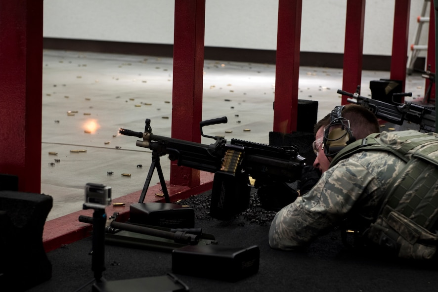 Staff Sgt. Daniel Lanata, 374th Security Forces Squadron 2018 Security Forces Advanced Combat Skills Assessment team member, fires the M249 light machine gun during training, May 31, 2018, at Yokota Air Base, Japan.