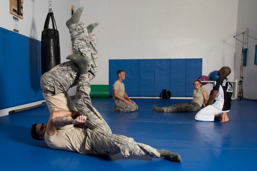Members of the 374th Security Forces Squadron 2018 Security Forces Advanced Combat Skills Assessment team practice hand-to-hand combat, May 31, 2018, at Yokota Air Base, Japan.