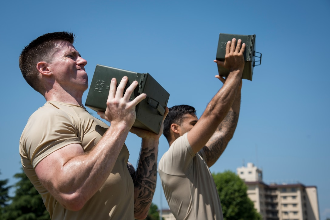 Staff Sgt. Daniel Lanata, 374th Security Forces Squadron 2018 Security Forces Advanced Combat Skills Assessment team member, performs ammo can lift during group physical training, June 1, 2018, at Yokota Air Base, Japan.
