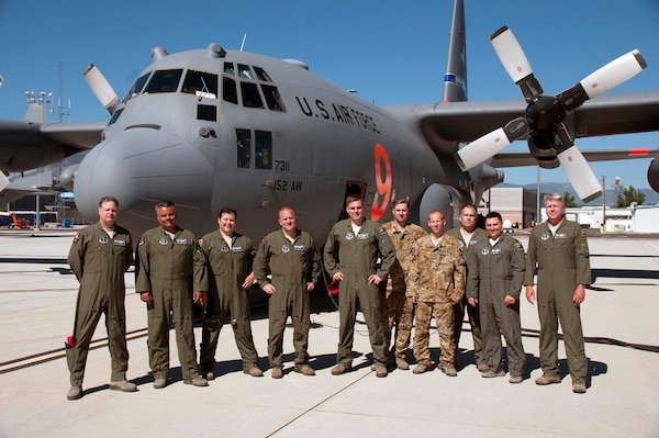 Aircrew with the 152nd Airlift Wing, Nevada Air National Guard, pose for a photo before departing Reno to assist federal firefighting agencies at Peterson Air Force Base for the Colorado fires on July 5, 2018.