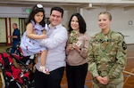 Pvt. Gracie Hilinski, Medical Section, Headquarters and Headquarters Battery, 2nd Battalion, 146th Field Artillery Regiment, 81st Stryker Brigade Combat Team poses with (from left to right) Lilya Soulami, Ayoub Soulami, and Asmae Hram, little girl, and her family, whose life was saved by Hilinski, at a ceremony at the National Guard Armory in Olympia, Wash., June 30, 2018. Hilinski saved the girl by administering cardiopulmonary resuscitation when her medical team made happened upon the emergency during a routine fuel stop, on April 6, 2018. (U.S. Army National Guard photo by Spc. Alec Dionne)