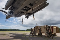 U.S. Marines with 2nd Transportation Support Battalion, Combat Logistics Regiment 2, help load a simulated vehicle during an external lift training exercise at Marine Corps Outlying Landing Field Atlantic, N.C., June 27, 2018. The training was conducted to enahnce readiness for landing support specialists with TSB-2 and Marine Heavy Helicopter Squadron 464.