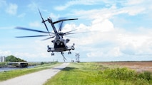 A U.S. Marine Corps CH-53E Super Stallion assigned to Marine Heavy Helicopter Squadron 464 takes off to conduct an external lift training exercise at Marine Corps Outlying Landing Field Atlantic, N.C., June 27, 2018. The training was conducted to enhance readiness for landing support specialists with TSP-2 and Marine Heavy Helicopter Squadron 464.