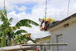 U.S. Army Corps of Engineers contractors work to restore the electrical grid in the Villa Alegria neighborhood of Caguas, Puerto Rico.