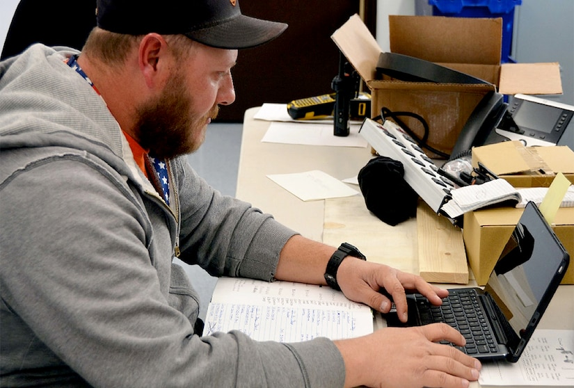 Phillip Fitz, a heating, ventilating and air conditioning controls mechanic, inputs data using a computer tablet instead of writing it in a notebook. The Installation Management Division is implementing a plan that issues employees in the field computer tablets to access information and input critical data for greater efficiency and timeliness.