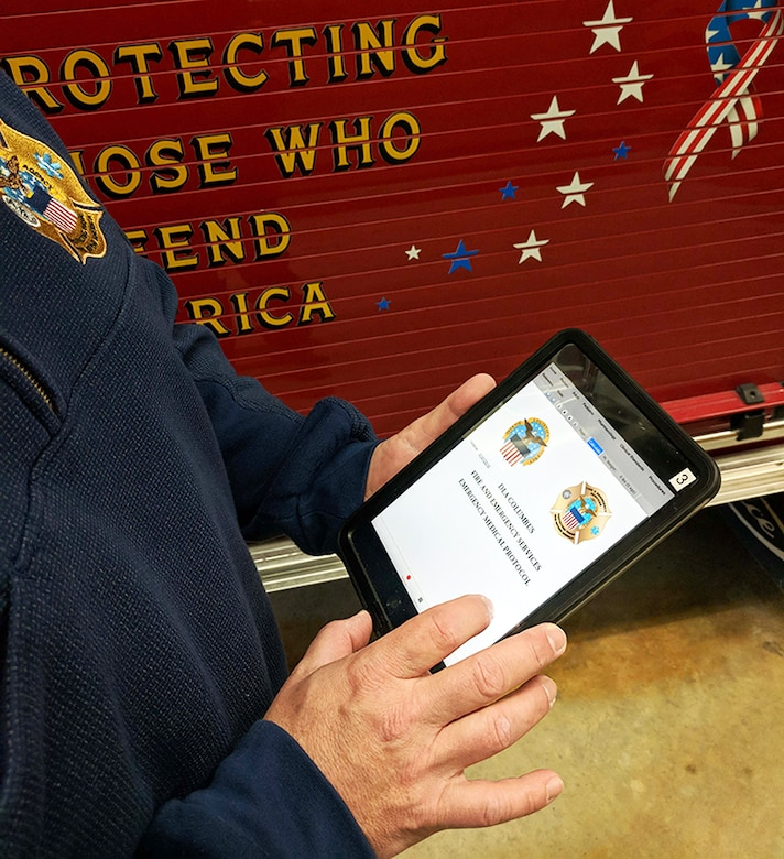 A member of DLA Installation Operations at Columbus' Fire and Emergency Services uses a handheld tablet to log in to Responsoft, an electronic medical protocol software. It allows the department to access procedures outlining correct patient care protocols without having to search through hundreds of paper copies.