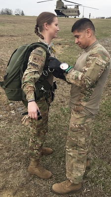 Army Sgt. First Class Franz Tovar, jumpmaster, conducts a pre-inspection of Army Staff Sgt. Brittany Sheehan before her military freefall jump.