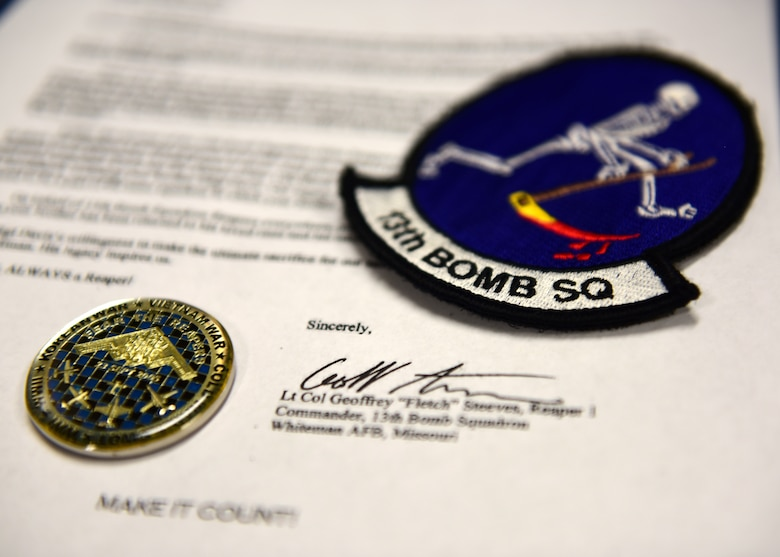 The current 13th Bomb Squadron patch and coin, along with a copy of the letter that was presented to the family of Army Air Force Staff Sgt. Roy Davis, a service member who was finally returned home after more than 70 years of being missing in action. Davis, a member of the 13th Bombardment Squadron of the 3rd Bombardment Group during World War II, received a proper burial with full military honors on June 23, 2018, in Ashby, Massachusetts.