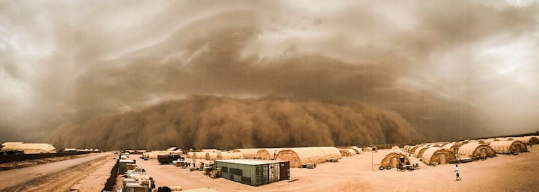 A thunderstorm collapses and causes air and dust to move through the atmosphere and transform into a sand storm at Nigerien Air Base 201, Niger, June 24, 2018. Air Base 201 was hit by four sandstorms throughout the last two weeks. (U.S. Air Force photo by Airman 1st Class Thomas Jamison)