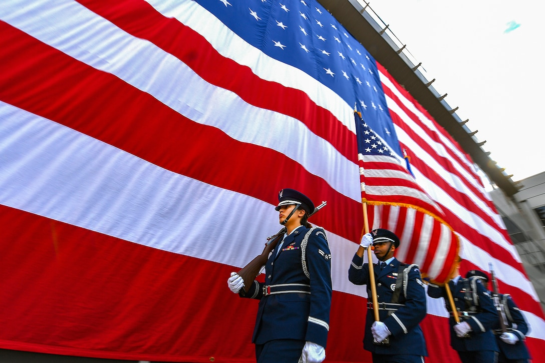 The High Frontier Honor Guard performs during the 50th Network Operations Group change of command ceremony at Schriever Air Force Base, Colo., June 29, 2018. During the ceremony, Col. Hewett Wells assumed command of the group from outgoing commander, Col. W. Scott Angerman. (U.S. Air Force photo by Dennis Rogers)