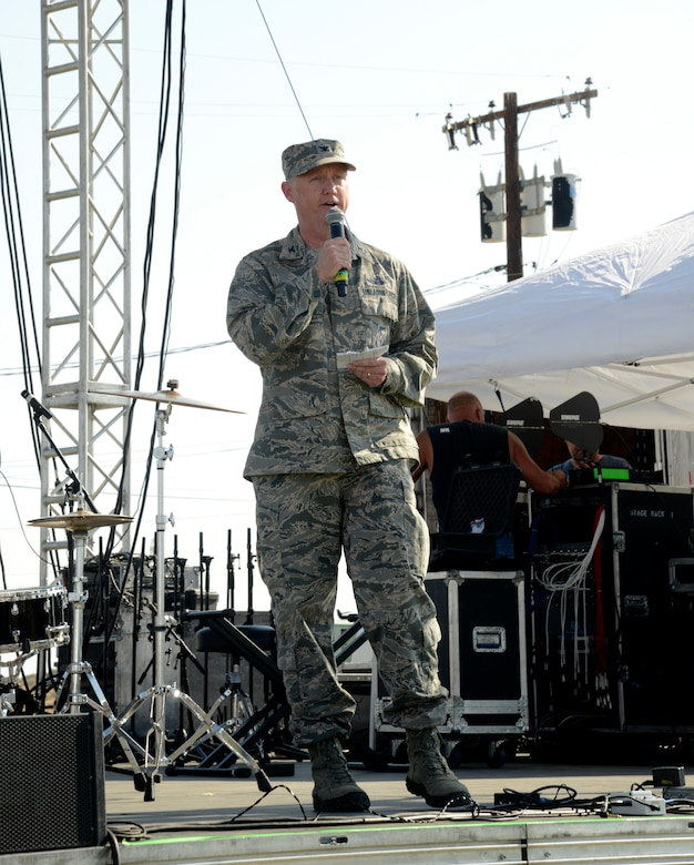"The 412th Test Wing vice commander, Col. Kirk Reagan, speaks to the crowd during the open ceremony at Wings Field, July4. During his remarks at the Summer Bash, Reagan remarked about the ""great family environment"" that exists at Edwards and that his family is proud to be back after several years away. (U.S. Air Force photo by Laura Motes)"