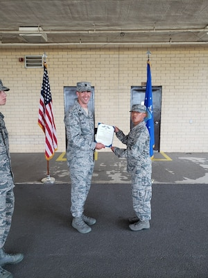 Airman Oh. H. Bang, a 737th Training Support Squadron trainee, receives the Air Force Commendation Medal June 21, 2018, Joint Base San Antonio-Lackland for his quick response and lifesaving actions which resulted in saving a fellow trainee's life.