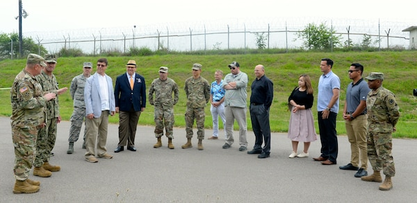 Local warfighters and Defense Logistics Agency personnel gather together at the new collection point on Camp Humphreys to celebrate its grand opening.