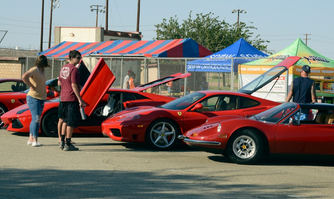 Exotic cars such as Porsche and Ferrari line the parking lot in front of Wings Field during the Summer Bash, July 4. More than 2,500 people came through the bash to see the striking vehicles. (U.S. Air Force photo by Laura Motes)
