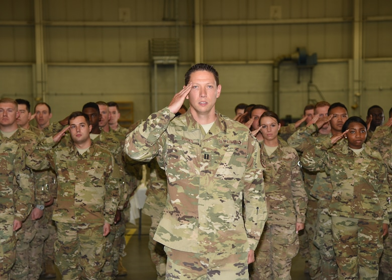 Defenders of the 90th Security Forces Squadron render a salute to Lt. Col. Nicholas Petren, their commander, at the 90th SFS Change of Command in the Peacekeeper High Bay on F.E. Warren Air Force Base, Wyo., July 6, 2018. Petren assumed command of the group during the ceremony which represents a formal transition of authority from the outgoing commanding to the incoming commander. (U.S. Air Force photo by Glenn S. Robertson)