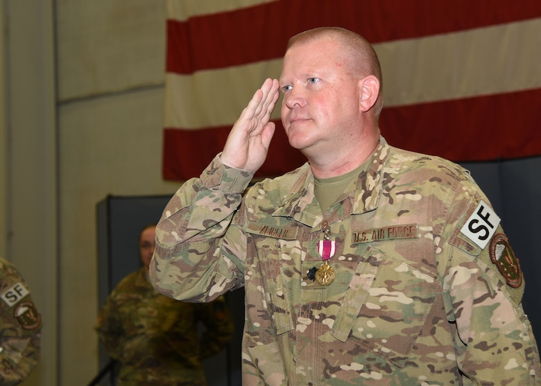 Lieutenant Colonel Richard Zeigler renders his final salute as commander to his troops at the 90th Security Forces Squadron Change of Command in the Peacekeeper High Bay at F.E. Warren Air Force Base, Wyo., July 6, 2018. Zeigler turned over command of the group to Lt. Col. Nicholas Petren during the ceremony, which represents a formal transition of authority from the outgoing commanding to the incoming commander. (U.S. Air Force photo by Glenn S. Robertson)