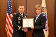 6th Medical Recruiting Battalion Commander, Lt. Col. Matthew Mapes, presents the PaYS certificate to Amy King, senior vice president and chief people manager, Centura Health, as part of ceremony to recognize the partnership at St. Anthony Hospital in Lakewood, Colo. on May 22, 2018.