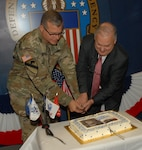 Defense Logistics Agency Troop Support Commander Army Brig. Gen. Mark Simerly (left) and Acquisition Executive William Kenny (right) cut Troop Support's birthday cake in Philadelphia July 6.