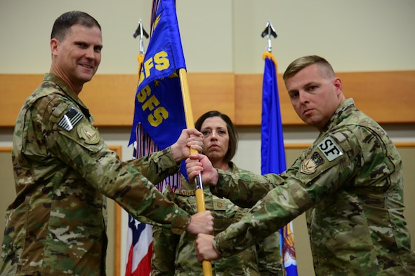 Maj. Michael Warren, right, accepts command of the 341st Security Forces Squadron from Col. Aaron Guill, 341st Security Forces Group commander, during an assumption of command ceremony July 6, 2018, at Malmstrom AFB, Mont.