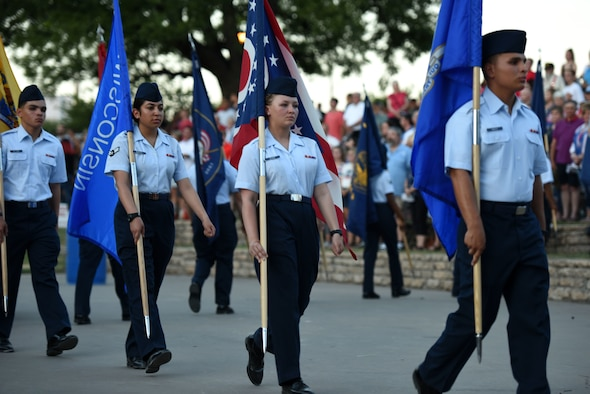Goodfellow volunteers present the 50 state flags during the 31st Annual San Angelo Symphony Pops Concert at the Bill Aylor Sr. Memorial RiverStage, San Angelo, Texas, July, 3, 2018. Attendees of the concert were able to enjoy a variety of patriotic songs from the symphony and a firework display at sundown. (U.S. Air Force photo by Airman 1st Class Seraiah Hines/Released)