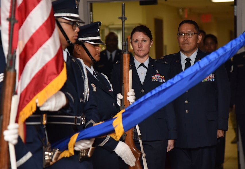 U.S. Air Force Col. Beatrice Dolihite, 81st Medical Group commander, and Lt. Col. Ryan Mihata, incoming 81st Surgical Operations Squadron commander, stand at attention during the 81st MSGS assumption of command ceremony at the Keesler Medical Center on Keesler Air Force Base, Mississippi, July 2, 2018. Mihata assumed command with the passing of a guidon, which is a ceremonial symbol of exchanging command from one commander to another. (U.S. Air Force photo by Kemberly Groue)