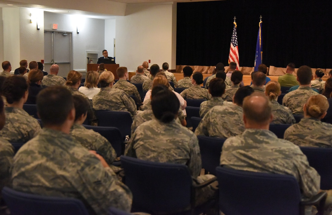 U.S. Air Force Lt. Col. Ryan Mihata, 81st Surgical Operations Squadron commander, delivers remarks during the 81st MSGS assumption of command ceremony at the Keesler Medical Center on Keesler Air Force Base, Mississippi, July 2, 2018. The passing of the guidon is a ceremonial symbol of exchanging command from one commander to another. (U.S. Air Force photo by Kemberly Groue)