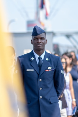 U.S. Air Force Senior Airman Alpha Ahamadou Oumar Tall, a career development technician with the 514th Force Support Squadron, 514th Air Mobility Wing, stands in recognition of the 29 nationalities represented during a U.S. Citizenship and Immigration Services naturalization ceremony held on board the Battleship New Jersey Museum and Memorial, located at Camden, N.J., July 4, 2018. Originally from Mali, Tall is the second member of his family to serve in the U.S. Armed Forces and the first to serve as a Reserve Citizen Airman. The 514th is an Air Force Reserve Command unit located at Joint Base McGuire-Dix-Lakehurst, N.J. (U.S. Air Force photo by Staff Sgt. Michael K. Hong)