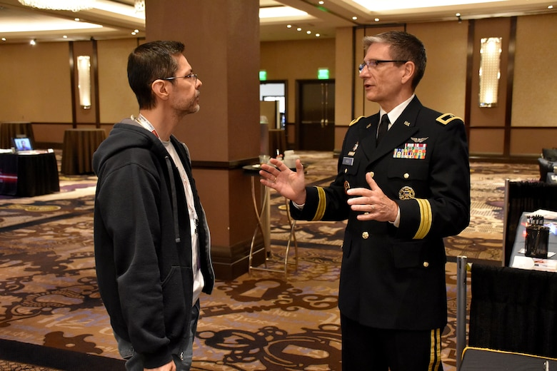 Brig. Gen. Joe Heck, Deputy Joint Staff Surgeon and Director, Reserve Readiness, speaks to an attendee of the Essentials of Emergency Medicine workshop at the Cosmopolitan Hotel in Las Vegas on 15 May. Heck was on hand with members of the 6th Medical Recruiting Battalion to explain the benefits and opportunities of a career in Army Medicine. For more information on the Army's more than 80 medical specialties, go online at healthcare.goarmy.com.