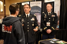 Brig. Gen. Joe Heck, Deputy Joint Staff Surgeon and Director, Reserve Readiness, and Capt. Nelson Kranz, Denver Medical Recruiting Company commander, speak to an attendee of the Essentials of Emergency Medicine workshop at the Cosmopolitan Hotel in Las Vegas on 15 May. Heck and Kranz were on hand with members of the 6th Medical Recruiting Battalion to explain the benefits and opportunities of a career in Army Medicine. For more information on the Army's more than 80 medical specialties, go online at healthcare.goarmy.com.