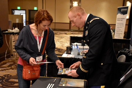 Capt. Nelson Kranz, Denver Medical Recruiting Company commander, hands out a brochure promoting Army health care to an attendee of the Essentials of Emergency Medicine workshop at the Cosmopolitan Hotel in Las Vegas on 15 May. Kranz was on hand with members of the 6th Medical Recruiting Battalion to explain the benefits and opportunities of a career in Army Medicine. For more information on the Army's more than 80 medical specialties, go online at healthcare.goarmy.com.