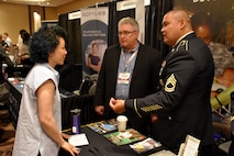 Sgt. 1st Class James Guevarra, U.S. Army health care recruiter with the Las Vegas Medical Recruiting Station, and Bruce Schamburek, education services specialist for 6th Medical Recruiting Battalion, speak to an attendee of the Essentials of Emergency Medicine workshop at the Cosmopolitan Hotel in Las Vegas on 15 May. Guevarra, Schamburek and other health care recruiters from the Denver Medical Recruiting Company, were on hand to explain the benefits and opportunities of a career in Army Medicine. For more information on the Army's more than 80 medical specialties, go online at healthcare.goarmy.com.