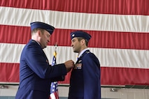 Col. Bradley Downs (left), vice commander of the 492nd Special Operations Wing, pins the Distinguished Flying Cross on Maj. Michael Tolzien, 58th Special Operations Wing during a ceremony July 6 at Kirtland Air Force Base.