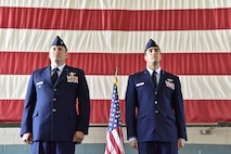 Col. Bradley Downs (left), vice commander of the 492nd Special Operations Wing, and Maj. Michael Tolzien, 58th Special Operations Wing, stand at attention during the reading of the award citation for the Distinguished Flying Cross at a ceremony July 6 at Kirtland Air Force Base.