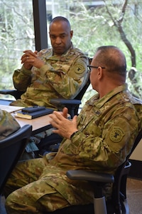 Command Sergeant Major Rene Hutchins, of the 6th Medical Recruiting Battalion, discusses aspects of medical recruiting with U.S. Army Recruiting Command's Deputy Commanding General of Operations, Brigadier General Kevin Vereen during the DCG-O's visit to the Phoenix Medical Recruiting Station.