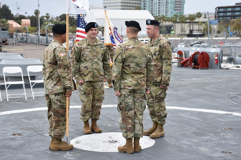 Lt. Col. Matthew Mapes, 6th Medical Recruiting Battalion commander, stands opposite the  outgoing and incoming company commanders and first sergeant for the Los Angeles Medical Recuiting Company Change of Command Ceremony on 11 May. The Los Angeles Medical Recruiting Company held their ceremony on the USS Iowa at the Port of Los Angeles and said farewell to Capt. Shawn Linhares while welcoming Capt. David O'hea as the incoming commander.