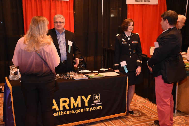 Bruce Schamburek, education services specialist for the 6th Medical Recruiting Battalion, and Captain Katie Flatt, U.S. Army health care recruiter from the Aurora Medical Recruiting Station, speak to attendees of the Trauma, Critical Care & Acute Care Surgery Conference at Caesars Palace on 10 April. Schamburek and Flatt were on hand, along with members of the Las Vegas Medical Recruiting Station, to explain the benefits and opportunities of a career in Army Medicine. For more information on the Army's more than 80 medical specialties go to healthcare.goarmy.com.