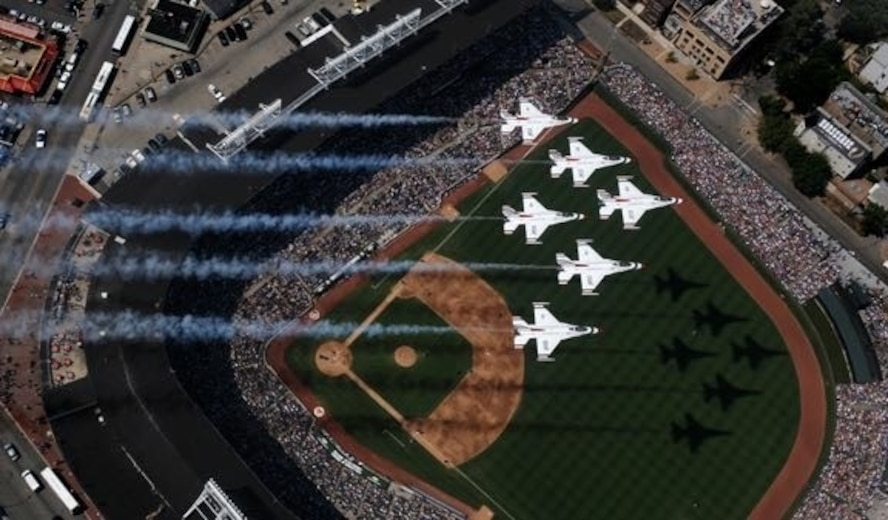 The U.S. Air Force Thunderbirds fly over Wrigley Field, prior to the start of their Friday practice for the Chicago Air and Water Show, 14 August 2009. The Thunderbirds represent the nearly 700,000 active duty, Air National Guard, Air Force Reserve and civilian Airmen serving in the United States and overseas. (U.S. Air Force photo by Capt. Kristi Machado)
