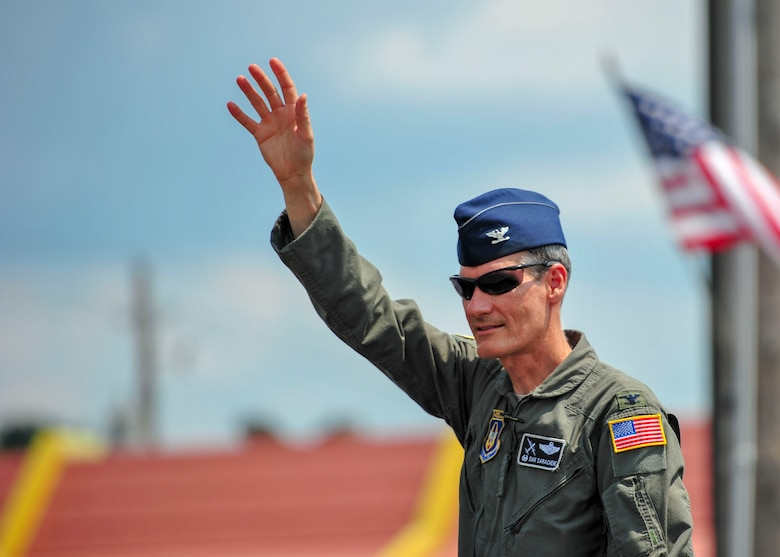 Col. Dan Sarachene, 910th Airlift Wing commander, waves to the crowd during a Fourth of July parade in Austintown, Ohio.