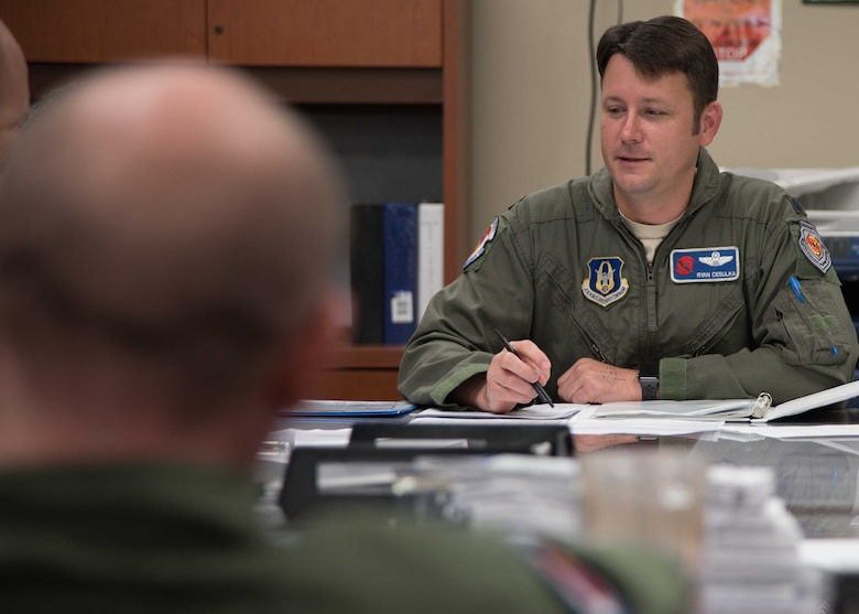 Lt. Col. Ryan Cesulka, 53rd Weather Reconnaissance Squadron pilot and aircraft commander for the mission into Tropical Storm Chris July 8, 2018, prebriefs the crew. The Air Force Reserve's Hurricane Hunters spent the weekend flying weather reconnaissance missions into Tropical Storm Chris off the North Carolina coastline and Tropical Storm Beryl in the Caribbean Sea to gather data for the National Hurricane Center in Miami. (U.S. Air Force photo/Maj. Marnee A.C. Losurdo)