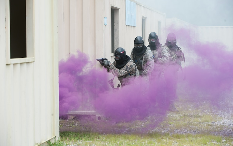 USAF Airmen practice close combat firearm skills