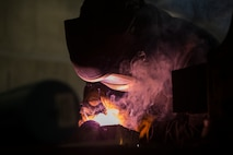 Lance Cpl. Christopher Alcazar, a welder with General Support Maintenance Company, 3rd Maintenance Battalion, Combat Logistics Regiment 35, 3rd Marine Logistics Group, welds a piece of scrap metal while practicing metalworking July 9, 2018 at Camp Kinser, Okinawa, Japan. GSM Co. is the largest Marine Corps metalworking shop in the Indo-Pacific region, providing III Marine Expeditionary Force with capabilities to manufacture a multitude of parts and components. Alcazar is a native of South El Monte, California.