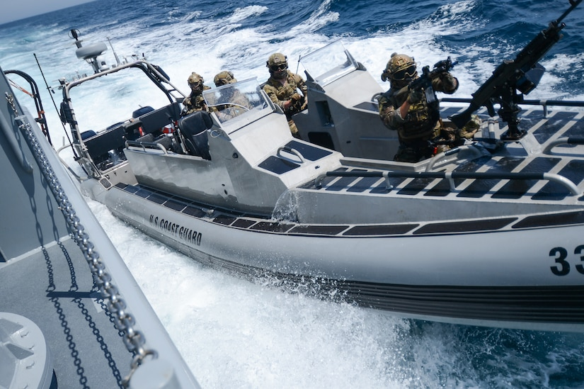 Coast Guard and Canadian navy personnel conduct maritime training.
