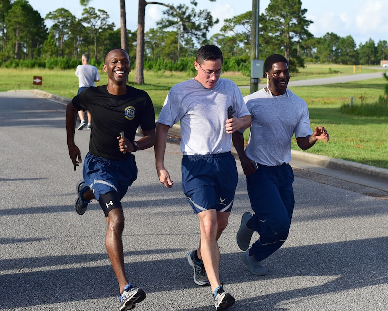 Airmen from all squadrons participate in the 325th Fighter Wing sports day July 3, 2018 at Tyndall Air Force Base, Fla. The sports day was designated as an opportunity for Airmen to work on their team building and Comprehensive Airmen Fitness. The day started out with a 5K run and continued with organized sporting events. (U.S. Air Force photo by Senior Airman Cody R. Miller/Released)